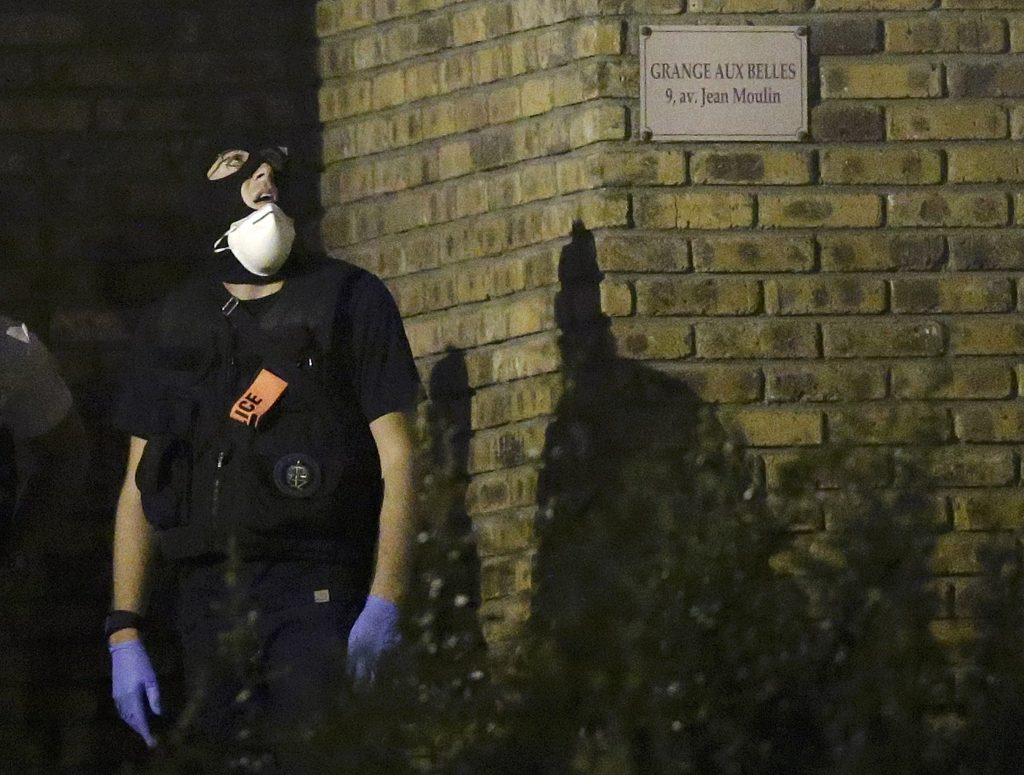 A French policeman takes part in a police raid at a residential buiding in Boussy-Saint-Antoine near Paris, France, September 8, 2016. French police investigating the abandonment of a car packed with gas cylinders near Paris's Notre Dame cathedral last Saturday, arrested three women on Thursday evening, in Boussy-Saint-Antoine, some 30 km south-east of Paris. REUTERS/Christian Hartmann