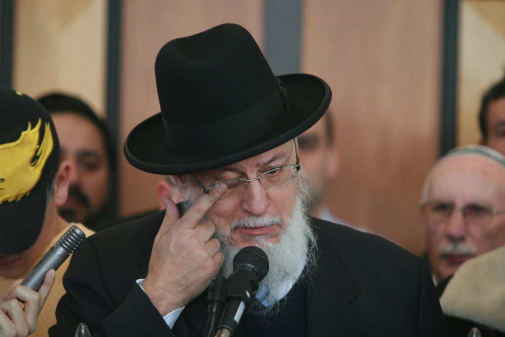 The French chief rabbi Joseph Sitruk wipes away a tear during a reinterment ceremony in Jerusalem for Ilan Halimi, a 23-year-old French Jew kidnapped and fatally tortured by a gang exactly a year ago on February 09. 2007. Halimi, a resident of a Parisian suburb, was lured by a young woman who entered the shop where he worked and persuaded him to meet her in another suburb, where he was kidnapped by a gang of youths, most of them immigrants. The abductors held Halimi hostage for three days and tortured him. Once the kidnappers concluded that the victim's parents were unable to pay the ransom they demanded, they dumped Halimi, who died of his wounds on his way to hospital. Photo by Olivier Fitoussi /Flash90 *** Local Caption *** àéìï çìéîé àæëøä éäåãé àðèéùîéåú öøôúé çèåó øöç øá éåñó ñéèøå÷