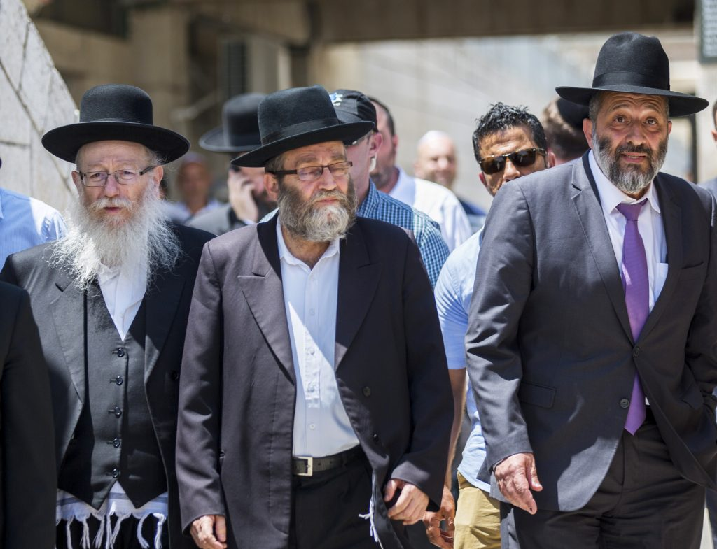 Minister of Health Yaakov Litzman, Israeli Interior Minister Aryeh Deri, United Torah Judaism parliament member Moshe Gafni and Rabbi of the Western Wall rabbi Shmuel Rabinovitch seen during a visit at the mixed-gender prayer section at the Western Wall in Jerusalem Old City on May 30, 2016. Photo by Yonatan Sindel/Flash90