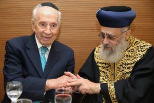 Chief SephardicRabbi of Israel Harav Yitzchak Yosef, seen former President Shimon Peres during the sheva brachos of Harav Yosef's daughter in March. Photo by Yaakov Cohen/Flash90