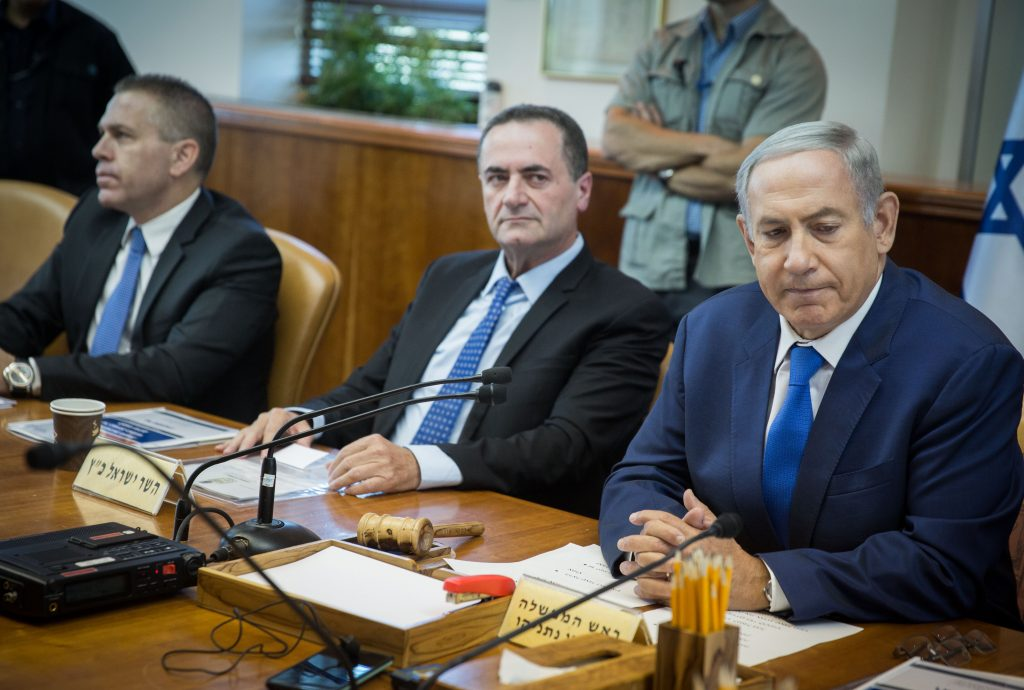 Israeli Prime Minister Benjamin Netanyahu seen next to Transportation Minister Israel Katz at the weekly cabinet meeting at PM Netanyahu's office in Jerusalem on September 4, 2016. Katz came under fire from the Ultra Orthodox parties for wanting to allow work on the railway on Saturday. Photo by Hadas Parush/Flash90