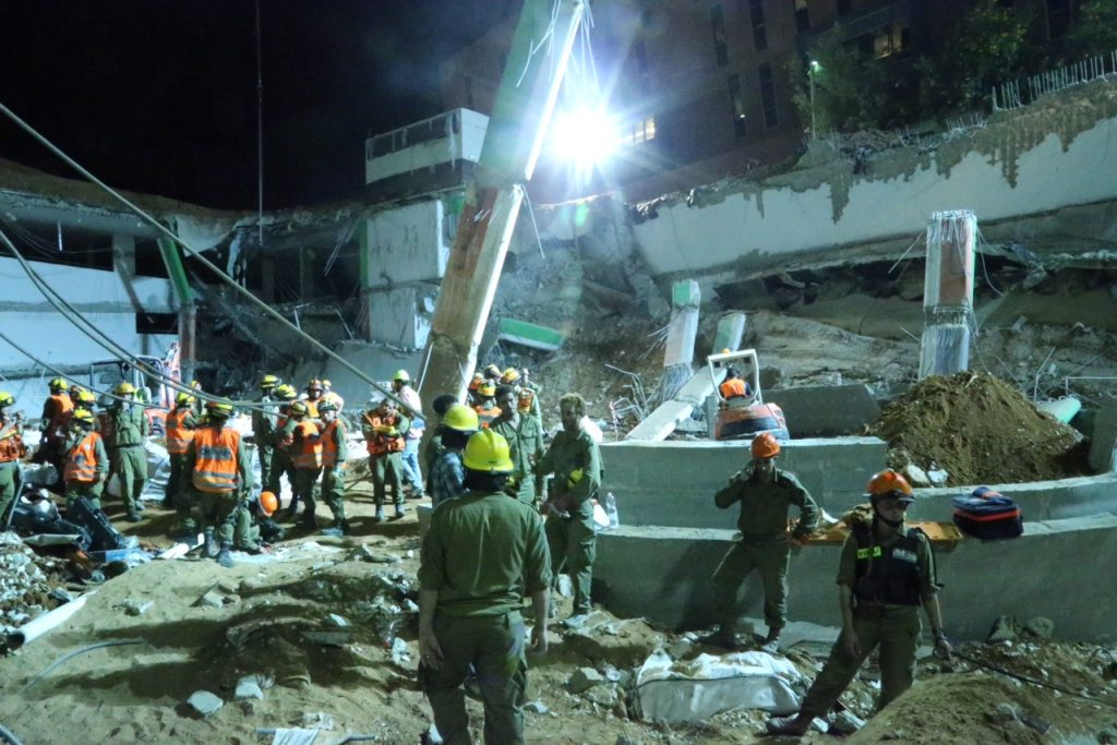 Rescue workers at the site of the building collapse on Monday night. (Flash90)