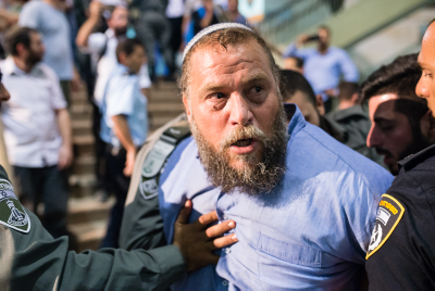 Lehava chairman Bentzi Gopstein is arrested by police outside a Christian event in Jerusalem on September 22, 2016. Photo by Dor Kedmi/Flash90