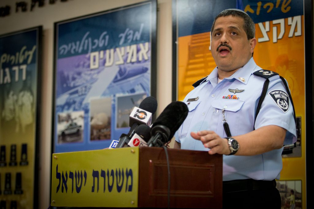 Israeli Chief of Police Roni Alsheikh speaking with the media Wednesday about the preparations for the funeral of Shimon Peres. (Yonatan Sindel/Flash90)