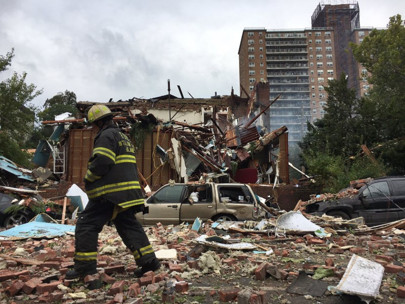 A New York City firefighter walks through debris after an explosion ripped through a home in the New York City borough of the Bronx, New York September 27, 2016. New York City Mayor's Office/Handout via Reuters