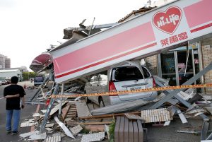 A damaged vehicle and convenience store in Kaohsiung, Taiwan. (Reuters/Tyrone Siu)