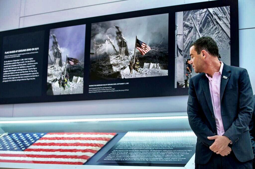9/11 Museum president Joe Daniels stands Thursday near the display for the American flag that firefighters hoisted at Ground Zero in the hours after the 9/11 terror attacks at the museum in New York. (9/11 Museum)