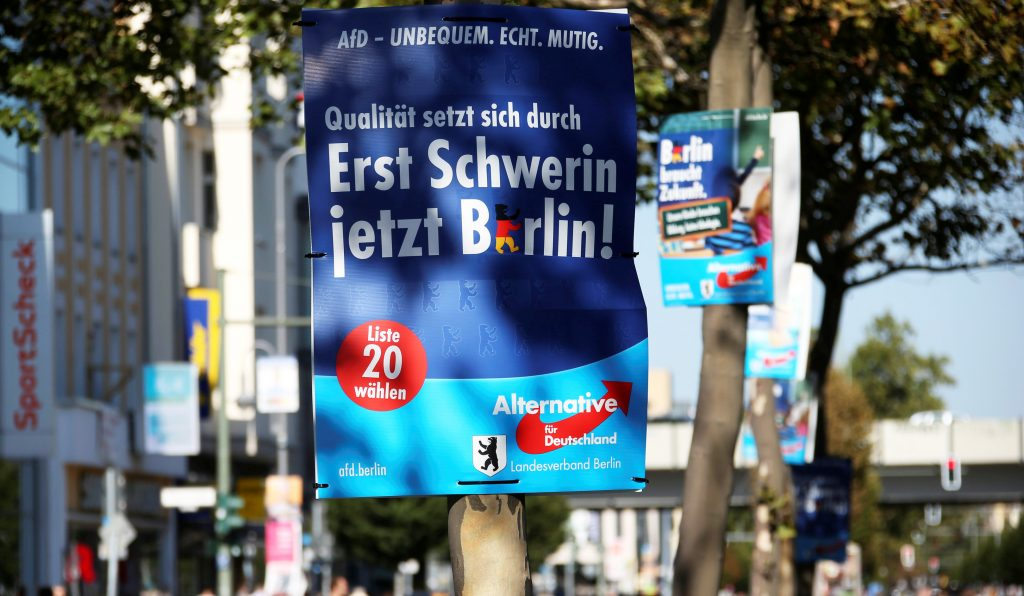 """Election posters of the anti-immigration party Alternative for Germany (AfD) for the upcoming local city elections are pictured in Berlin, Germany, September 15, 2016. The slogan reads """"Ensuring excellence. First Schwerin now Berlin!"""". REUTERS/Fabrizio Bensch"""