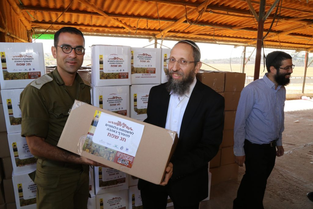 Jewish residents in Gush Etzion distributing food products on Monday to the IDF ahead of Rosh Hashanah and Sukkos. (Gershon Elinson/Flash90)