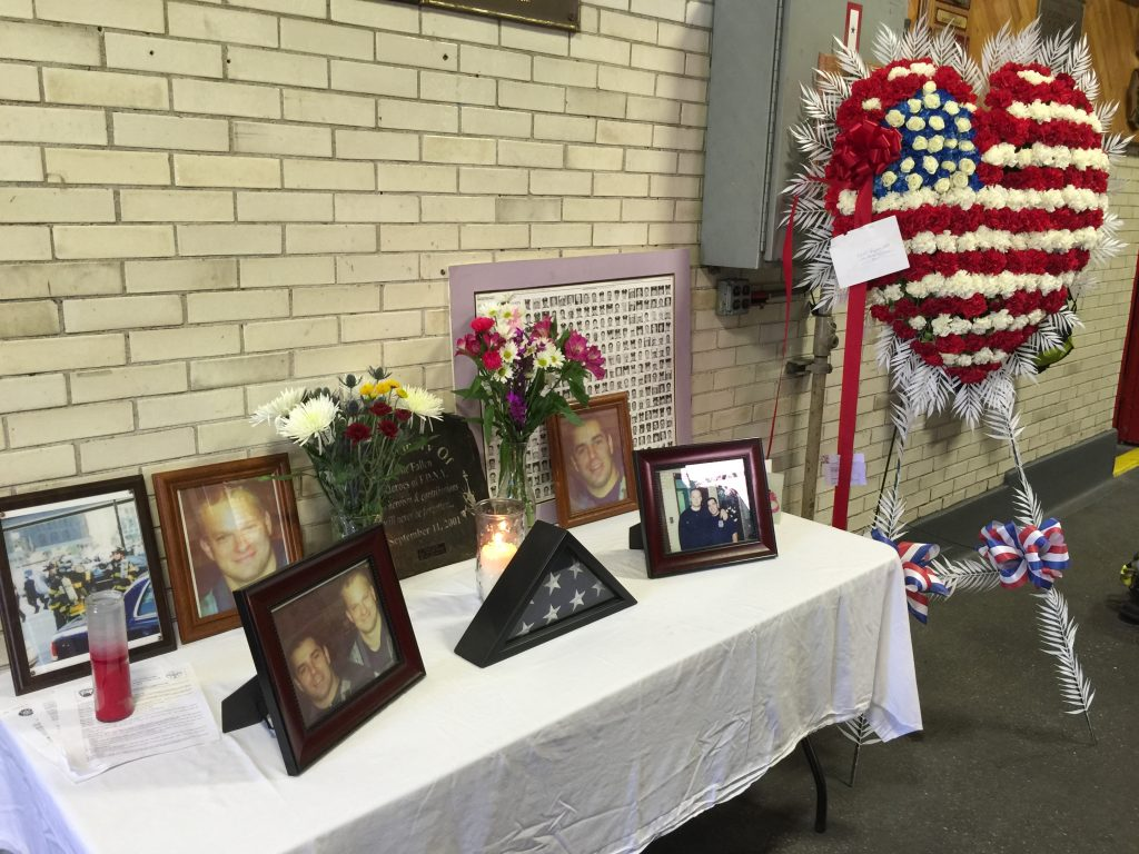 The memorial table set up in the Engine 150 station house on Sunday. (Yosef Caldwell/Hamodia)