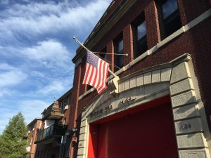 The flag at a firehouse in Brooklyn flies at half-mast Tuesday, in honor of fallen FDNY battalion chief Michael Fahy. (Yosef Caldwell)