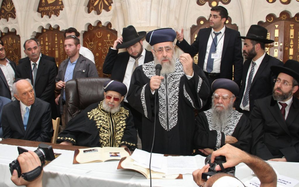 Shas spiritual leader Rabbi Ovadia Yosef , Chief Rabbi Yitzhak Yosef and Israeli president Shimon Peres seen during a ceremony at the at the Rabban Yohanan Ben Zakai Synagogue in Jerusalem old city on September 16, 2013, New Sephardi Chief Rabbi Yitzhak Yosef got the traditional cloak and cap for the first time and become officially the Sephardi Chief Rabbi of Israel. (Yaakov Cohen)