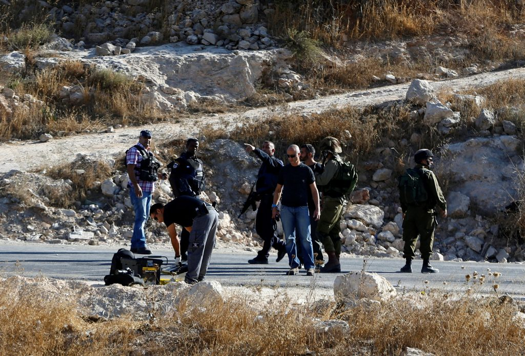 Israeli security forces stand at the scene where a Palestinian attempted to stab an Israeli soldier at the entrance to the West Bank village of Bani Na'im, near Hebron September 20, 2016. REUTERS/Mussa Qawasma