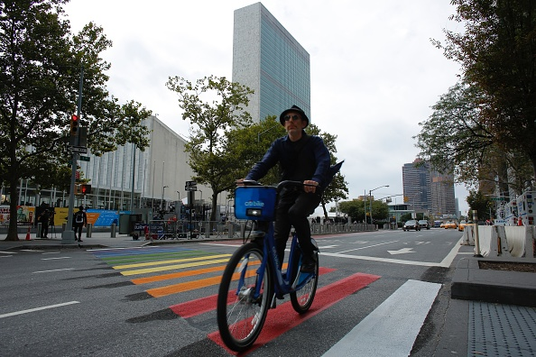 A man on a bike passes by United Nations Headquarters in New York on Sunday as world leaders began to arrive for the U.N. General Assembly. (KENA BETANCUR/AFP/Getty Images)