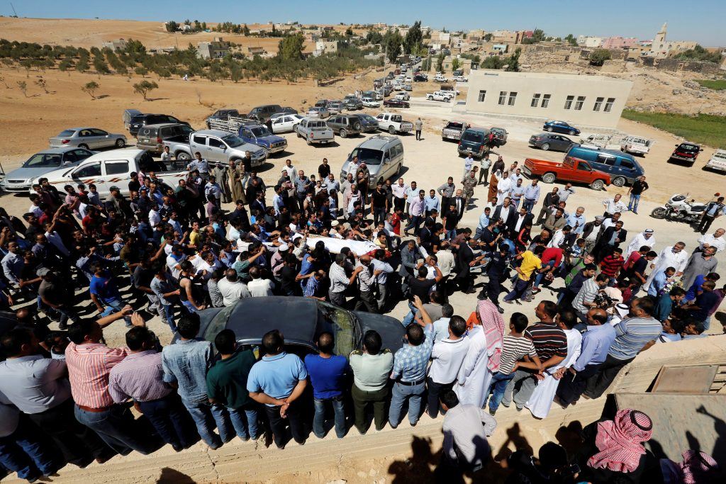 Relatives of Saed Amro, the Jordanian who was shot dead by Israeli police at the Damascus gate in the Old City, carry his body during his funeral in the town of Mugheir, Jordan. (Muhammad Hamed/Reuters)