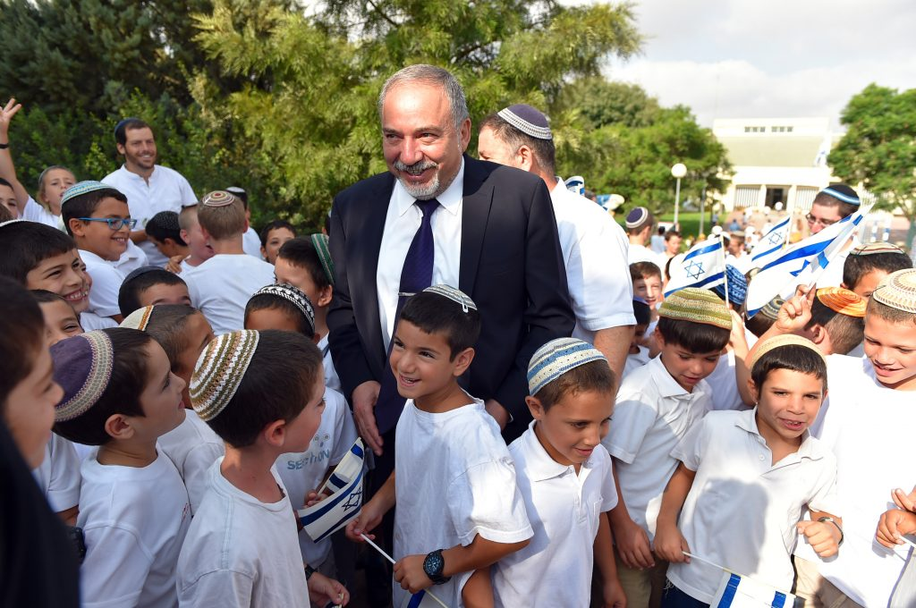 Israeli Minister of Defense Avigdor Liberman on a visit on the first day of school in Susya, Thursday. (Ariel Hermoni/Ministry of Defense)