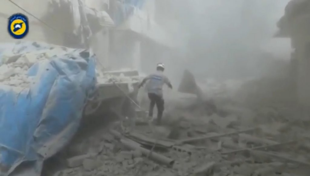 A still image taken on September 7, 2016 from a video posted on social media said to be shot in Aleppo's Al Sukari on September 6, 2016, shows a civil defense member making his way through debris, after a suspected chlorine gas attack, Syria. Social Media via Reuters TV ATTENTION EDITORS - THIS IMAGE WAS PROVIDED BY A THIRD PARTY. EDITORIAL USE ONLY. NO RESALES. NO ARCHIVE. REUTERS IS UNABLE TO INDEPENDENTLY VERIFY THIS IMAGE.