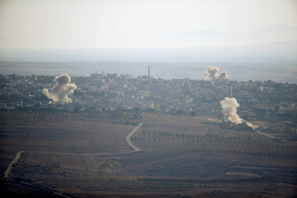 REFILE - ADDITIONAL CAPTION INFORMATIONSmoke from explosions rises during fighting in the village of Jubata Al Khashab, held by Syrian rebel groups fighting to overthrow President Bashar al-Assad, as seen from the Israeli side of the border fence between Syria and the Israeli-occupied Golan Heights September 11, 2016. REUTERS/Baz Ratner TPX IMAGES OF THE DAY