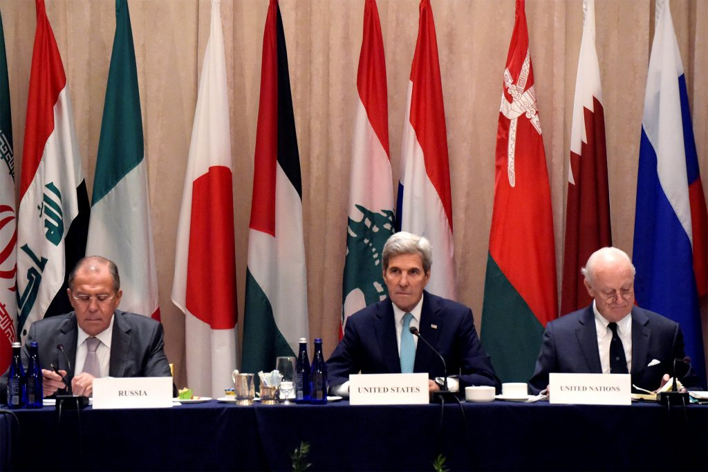 U.S. Secretary of State John Kerry (C), United Nations Special Envoy for Syria Staffan de Mistura and Russian Foreign Minister Sergei Lavrov (L) attend the International Syria Support Group Meeting at the Palace Hotel in Manhattan, New York, U.S., September 20, 2016. REUTERS/Darren Ornitz