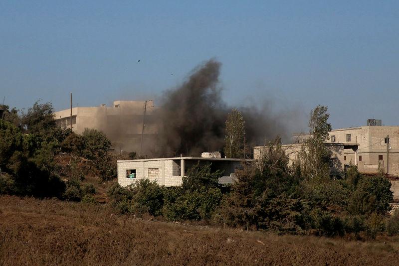 Smoke rises due to shelling on the rebel controlled town of Jubata al-Khashab, in Quneitra countryside, Syria September 15, 2016. REUTERS/Alaa Al-Faqir