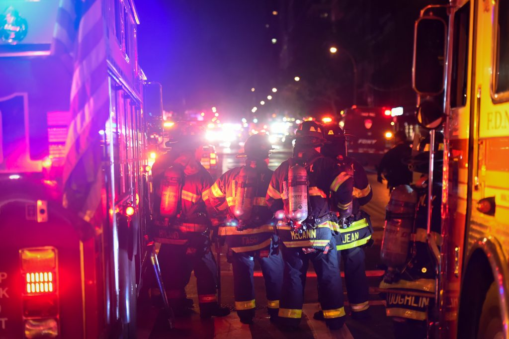 New York City firefighters stand near the site of an explosion in the Chelsea neighborhood of Manhattan, New York, U.S. September 17, 2016. REUTERS/Rashid Umar Abbasi TPX IMAGES OF THE DAY