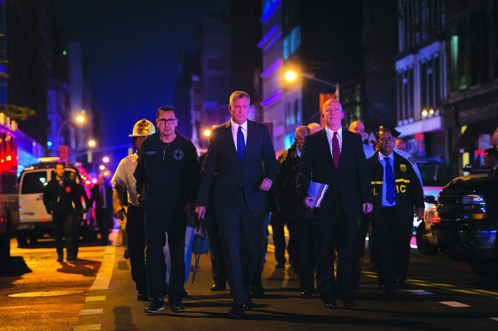 Mayor Bill de Blasio, center, and NYPD Chief James O'Neill, center right, at a press conference Saturday near the scene of the Chelsea explosion. (Michael Appleton/Mayoral Photography Office)