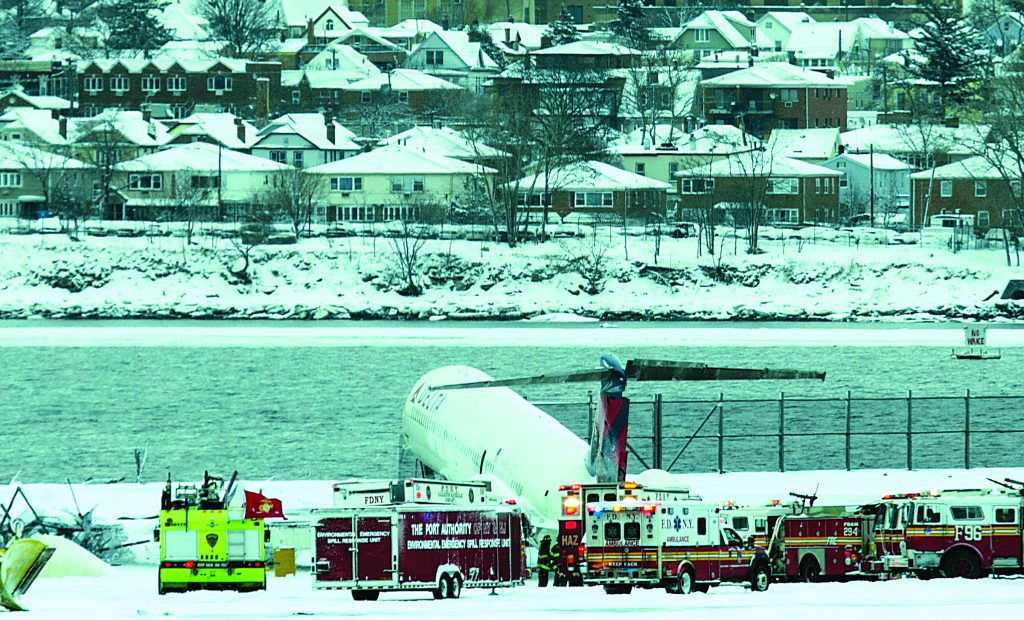A Delta Air Lines jet rests over an icy Flushing Bay after it skidded off a snowy runway at LaGuardia Airport in March 2015. (AP Photo/Craig Ruttle)