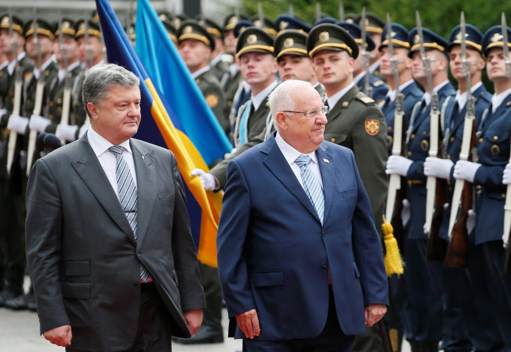 Ukrainian President Petro Poroshenko (L) and Israeli President Reuven Rivlin walk past honor guards during a welcoming ceremony in Kiev, Ukraine, on Tuesday. (Reuters/Gleb Garanich)