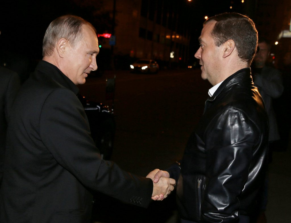 Russian President Vladimir Putin greets Prime Minister and Chairman of the United Russia party Dmitry Medvedev during a visit to the party's campaign headquarters following a parliamentary election in Moscow, Russia, September 18, 2016. Sputnik/Pool/Ekaterina Shtukina via REUTERS ATTENTION EDITORS - THIS IMAGE WAS PROVIDED BY A THIRD PARTY. EDITORIAL USE ONLY. TPX IMAGES OF THE DAY