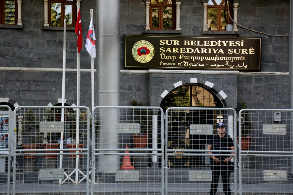 A riot police officer stands guard in front of Sur municipality office, following the removal of the local mayor from office after he was deemed to support Kurdish militants, in Diyarbakir, Turkey, September 11, 2016. REUTERS/Sertac Kayar