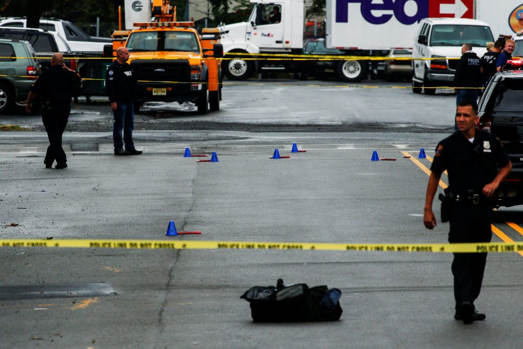 Law enforcement officers mark evidence near the site where Ahmad Khan Rahami, sought in connection with a bombing in New York, was taken into custody in Linden, New Jersey, U.S., September 19, 2016. REUTERS/Eduardo Munoz