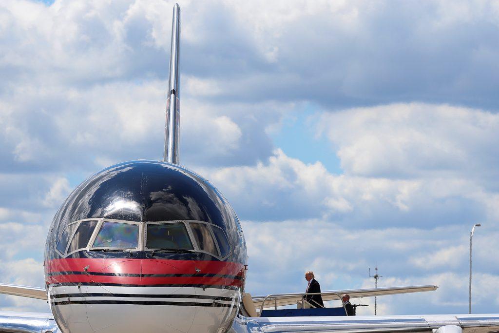 Republican presidential nominee Donald Trump boards his plane in Detroit, Michigan, U.S., September 3, 2016. REUTERS/Carlo Allegri