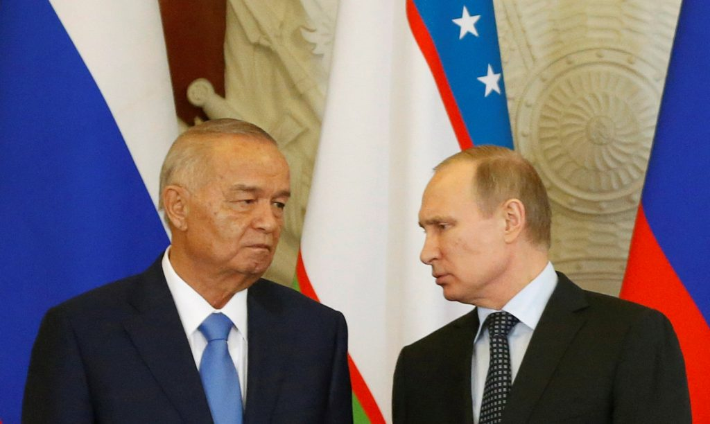 FILE PHOTO - Russian President Vladimir Putin (R) talks to Uzbek President Islam Karimov during a signing ceremony following their meeting at the Kremlin in Moscow, Russia, April 26, 2016. REUTERS/Maxim Shemetov/File Photo