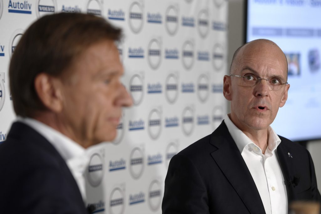 Hakan Samuelsson of MD Volvo Cars Group (L) and Jan Carlson, MD Autoliv, speak during a press conference in Stockholm, Sweden, on Tuesday. (Henrik Montgomery/TT via AP)