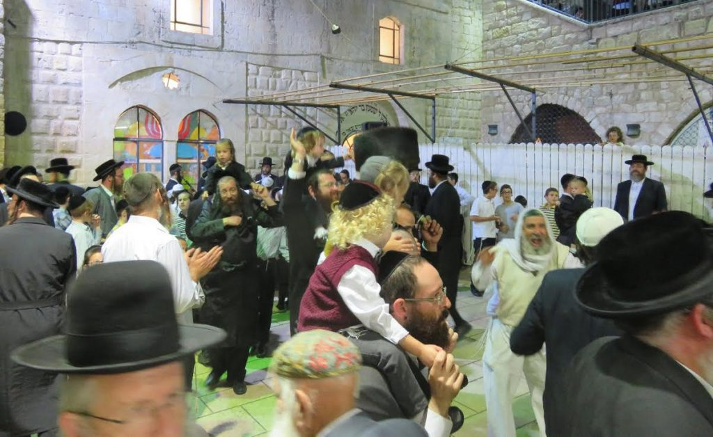 Dancing in the courtayrd in Meron with the newly shorn boys. (Ohel HaRashbi)