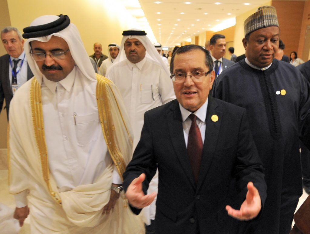 In this photo dated Wednesday, Sept. 28, 2016, Algerian Energy Minister Noureddine Boutarfa, center, gestures as he leaves the International Conference Center in Algiers, Algeria, with Minister of Energy and Industry of Qatar, Bin Saleh Al-Sada (L), and acting Secretary General of OPEC Mohammed Barkindo, after a meeting of oil ministers of the Organization of the Petroleum Exporting countries, OPEC, in Algiers, Algeria. (AP Photo/Sidali Djarboub)