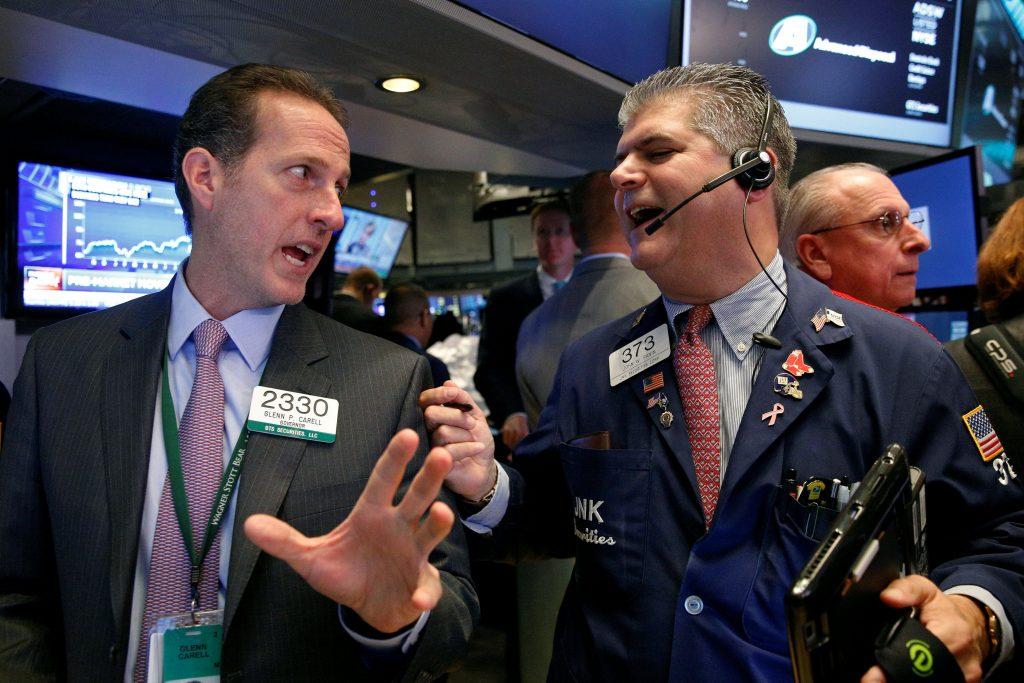 Traders work on the floor of the New York Stock Exchange on Thursday. (Reuters/Brendan McDermid)