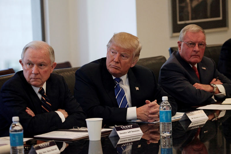 Republican presidential nominee Donald Trump sits with U.S. Senator Jeff Sessions (R-AL) (L) and retired U.S. Army General Keith Kellogg (R) during a national security meeting with advisors at Trump Tower in Manhattan. (Mike Segar/Reuters)