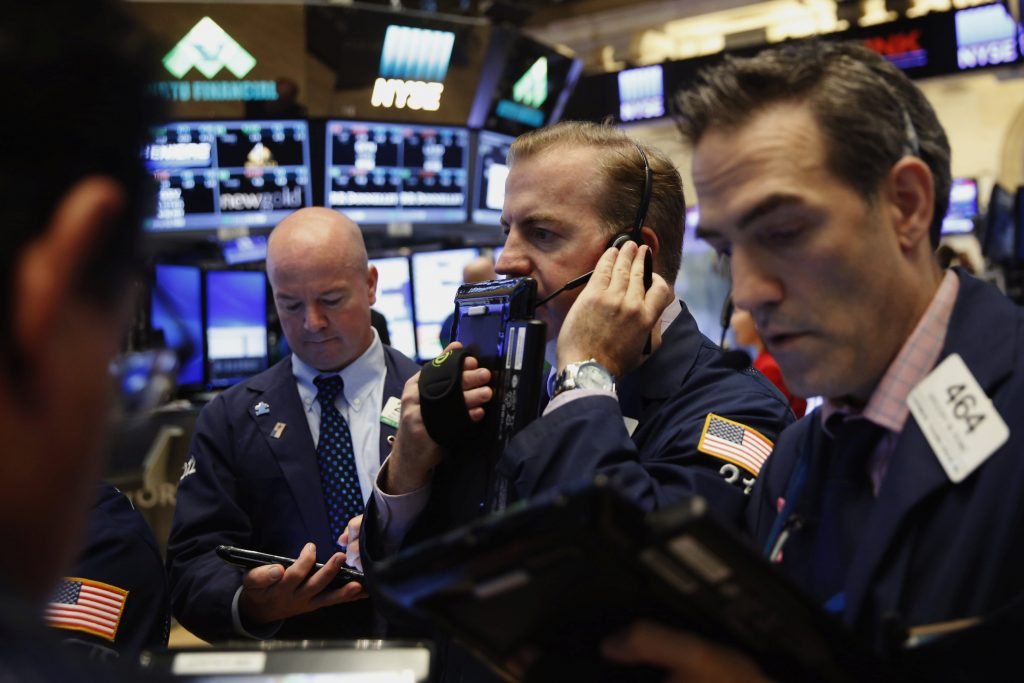 Traders work on the floor of the New York Stock Exchange on Wednesday. (Reuters/Lucas Jackson)