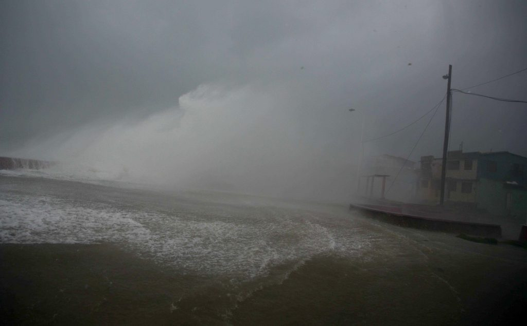 Surf and wind from Hurricane Matthew crash on the waterfront in Baracoa, Cuba, Tuesday, Oct. 4, 2016. The dangerous Category 4 storm blew ashore around dawn in Haiti. It unloaded heavy rain as it swirled on toward a lightly populated part of Cuba and the Bahamas. (AP Photo/Ramon Espinosa)