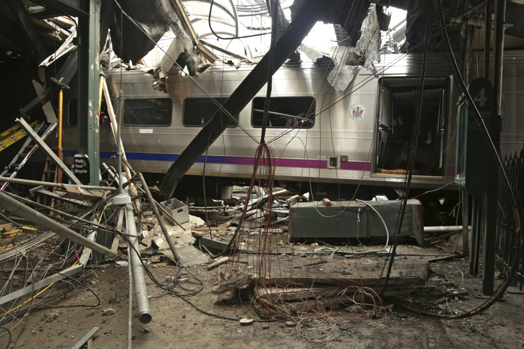 The aftermath of the crash at This Oct. 1, 2016, file photo, provided by the National Transportation Safety Board shows damage done to the Hoboken Terminal in Hoboken, N.J., (Chris O'Neil/NTSB photo via AP, File)