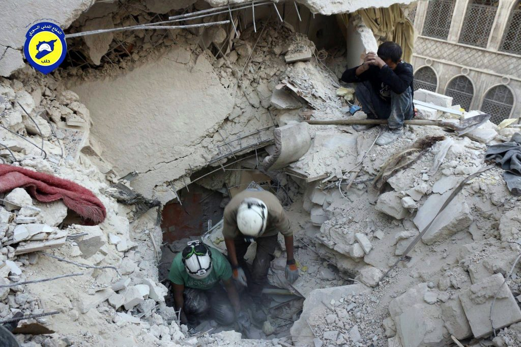 This Tuesday, Oct. 4, 2016 photo, provided by the Syrian Civil Defense group known as the White Helmets, shows Civil Defense workers from the White Helmets digging in the rubles to remove bodies and look for survivors, after airstrikes hit the Bustan al-Basha neighborhood in Aleppo, Syria. The implosion of diplomatic talks with Russia has left the Obama administration with a series of bad options for what to do next in Syria. Despite harrowing scenes of violence in Aleppo and beyond, President Barack Obama is unlikely to approve any risky new strategy before handing the civil war over to his successor early next year. (Syrian Civil Defense White Helmets via AP)