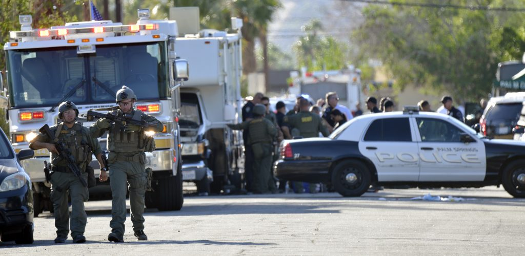 Riverside Country Sheriffs Deputies stand near the scene of the shooting in Palm Springs, Calif., on Saturday. (AP Photo/Rodrigo Peña)
