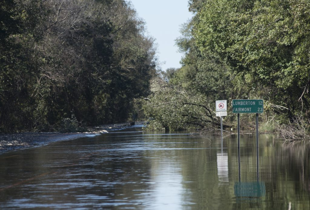 Floodwaters caused by rain from Hurricane Matthew block NC Highway 41 west outside Lumberton, N.C., on Monday. (AP Photo/Mike Spencer)