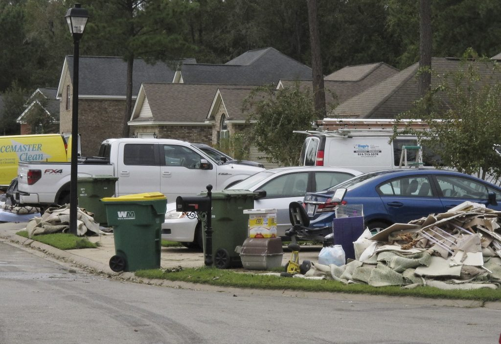 Debris is piled by the curb in Pooler, Ga., in the aftermath of Hurricane Matthew. (AP Photo/Russ Bynum)