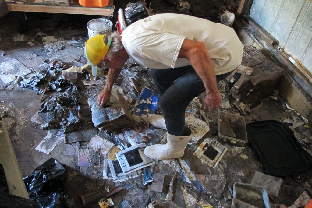 Walter Coker surveys the damage in his furniture storage shed in Crescent Beach, Fla. (AP Photo/Jason H. Dearen)