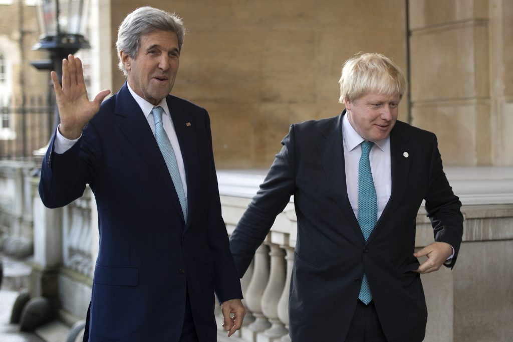 US Secretary of State John Kerry (L) is greeted by British Foreign Secretary Boris Johnson ahead of a meeting on the situation in Syria, at Lancaster House in London, on Sunday. (Justin Tallis/Pool via AP)
