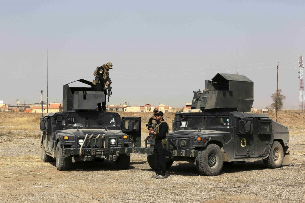 Iraqi forces prepare during an offensive to retake Mosul from Islamic State militants outside Mosul, Iraq, Wednesday, Oct. 19, 2016. A senior Iraqi general on Wednesday called on Iraqis fighting for the Islamic State group in Mosul to surrender as a wide-scale operation to retake the militant-held city entered its third day. (AP Photo/Khalid Mohammed)