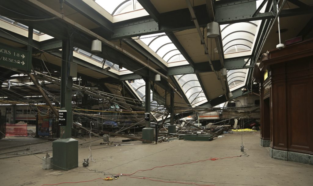 FILE - This Oct. 1, 2016, file photo provided by the National Transportation Safety Board shows damage done to the Hoboken Terminal in Hoboken, N.J. (Chris O'Neil/NTSB photo via AP, File)