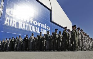 In this Nov. 30, 2011 photo, California Army National Guard soldiers at Moffett Federal Airfield in Mountain View, Calif., watch the arrival of the body of soldier Sean Walsh, who died during a combat operation in Afghanistan. (AP Photo/Paul Sakuma, File)